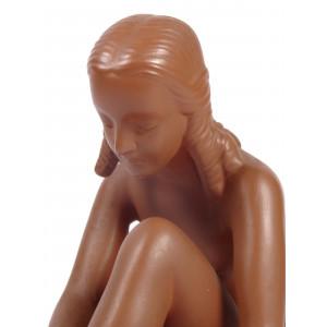 Nude Girl Tying Shoe by...