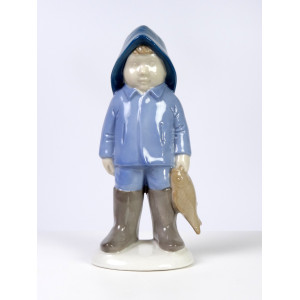 Boy with Fish Figurine by...